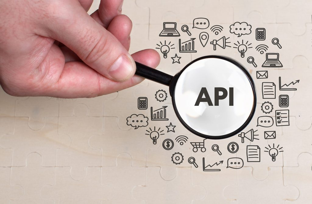Business, technology, internet and network concept. Young businessman thinks over the steps for successful growth: API